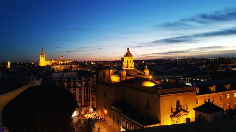 City Cityscape Travel Destinations Architecture Urban Skyline Tower Skyscraper Business Finance And Industry Modern Tourism Sunset Office Aerial View Clock Cultures Scenics Downtown District No People Night Outdoors Sevilla Seville Metropol Parasol Giralda Giraldillo