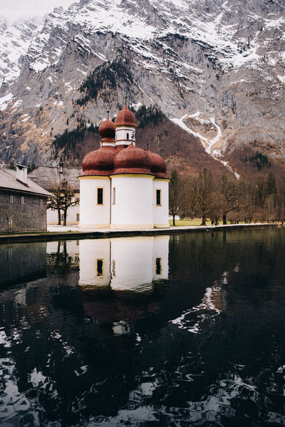 View of St. Bartholomä on the Lake Königssee, Bavaria, Germany approaching via boat. Church Königssee Reflection Schönau Am Königsee Sightseeing St. Bartholomä Travel Winter Alps Barren Bavarian Alps Europe From The Water Level Germany IPhoneography Iconic Lake Landmark Mobilephotography Mountain Simplicity Solitude Symmetry Travel Destinations Vertical