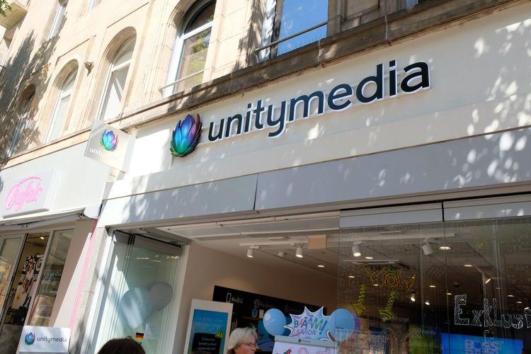 Mannheim, Germany - August 23, 2017: Unitymedia GmbH store. German cable network operator based in Cologne, which was originally created in 2005 by the merger of iesy, ish and Tele Columbus West Brand Media Operator Retail  Shop Store Store Sign Technology Unitymedia