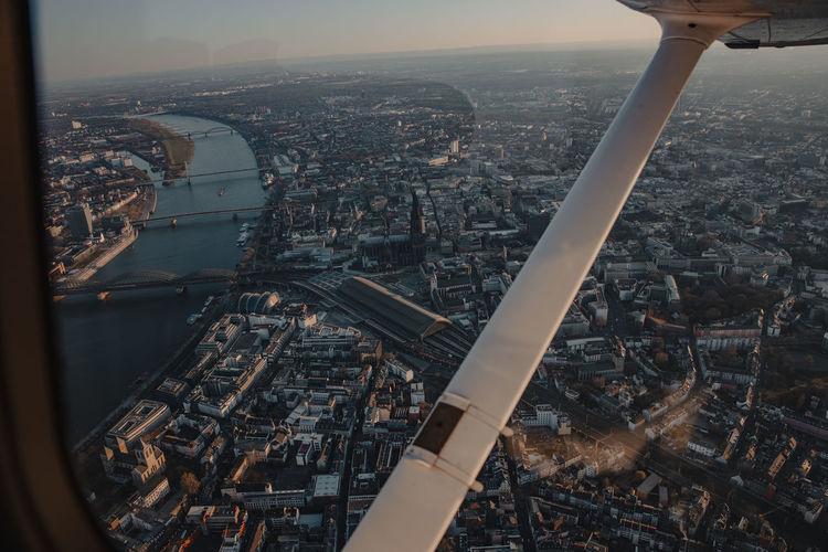 Sunset flight over cologne, germany
