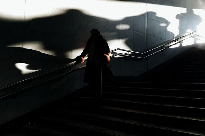In shade One Person Silhouette Shadows Shadow VSCO Vscocam Street Photo Street Portrait Street Photography Streetphotography Streetphoto Street Outdoors Stairs The City Light Welcome To Black