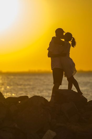 Love Sunset Water Sea Sky Real People Beauty In Nature Orange Color Two People Adult Outdoors Beach