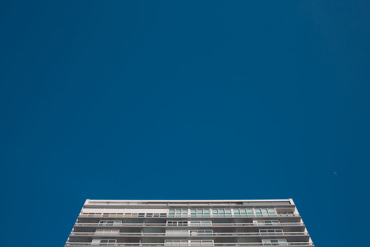Apartment Architecture Blue Building Building Exterior Built Structure City Clear Sky Copy Space Day Directly Below Height High Section Low Angle View Modern Nature No People Office Office Building Exterior Outdoors Sky Skyscraper Tall - High