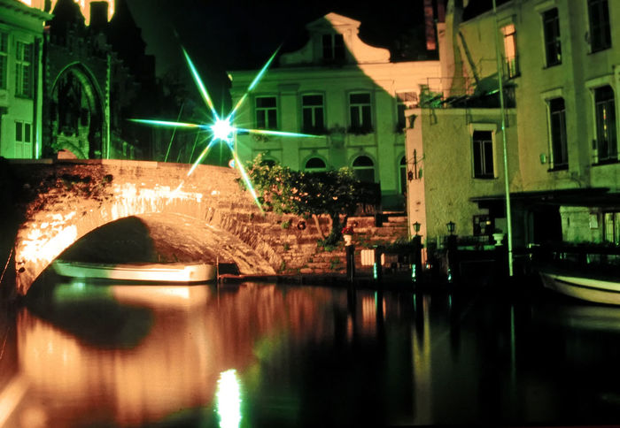 View along a side canal - Brugge, Belgium Architecture Reflection Night Water City Sky Outdoors Illuminated Waterfront No People Night Shots  Brugge, Belgium Building Exterior Built Structure Bridge - Man Made Structure A Taste Of Brugge Brugge Canals HUAWEI Photo Award: After Dark