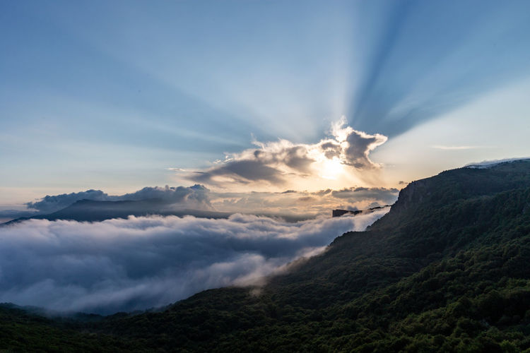 Sky Cloud - Sky Beauty In Nature Scenics - Nature Tranquil Scene Tranquility Nature Mountain Environment No People Idyllic Sunset Landscape Non-urban Scene Outdoors Sunlight Mountain Range Majestic Dramatic Sky Bright