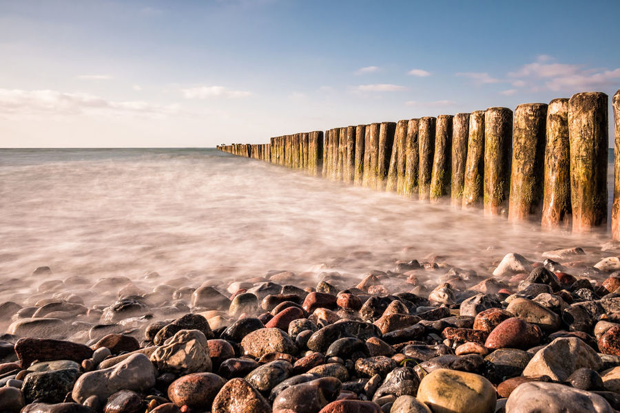 Groyne on shore of the Baltic Sea. Baltic Sea Beach Beauty In Nature Bulb Cloud - Sky Day Groynes Horizon Over Water Long Exposure Nature Nienhagen Germany No People Outdoors Pebble Beach Scenics Sea Sky Stones Tourism Travel Vacation Water