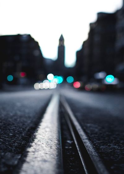 Close-up of illuminated railroad track at night