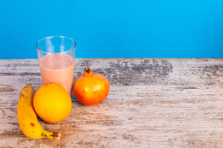 Grenade Banana Orange Color Smoothie Food And Drink Healthy Eating Wellbeing Glass Drinking Glass Fruit Drink Refreshment Food Freshness Wood - Material No People Citrus Fruit Orange - Fruit Healthy Lifestyle Table Orange Pitcher - Jug Fruit Juice Non-alcoholic Beverage Antioxidant