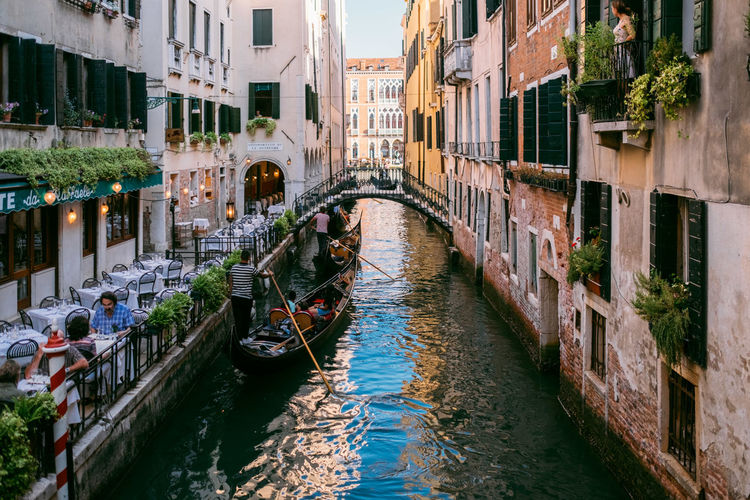 Venice Water Canal Built Structure Nautical Vessel Building Exterior Architecture Transportation Mode Of Transportation Waterfront City Building Day Nature Moored Travel Destinations Incidental People Residential District Group Of People Gondola - Traditional Boat Outdoors Wooden Post Passenger Craft