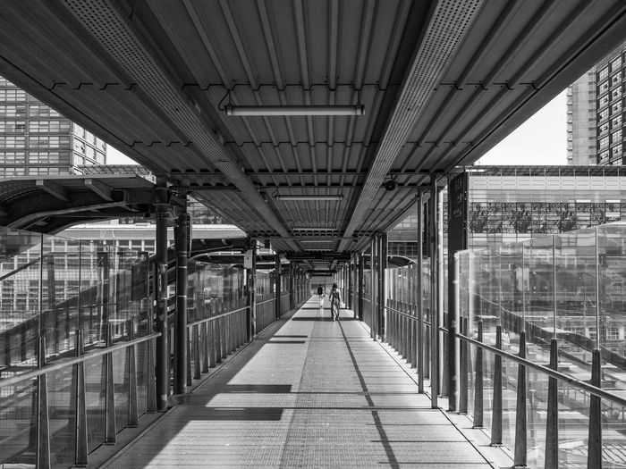 Architecture Built Structure Direction The Way Forward Bridge Bridge - Man Made Structure Diminishing Perspective Connection Railing Transportation Day Indoors  Incidental People Elevated Walkway Footpath Footbridge City Building Architectural Column Ceiling