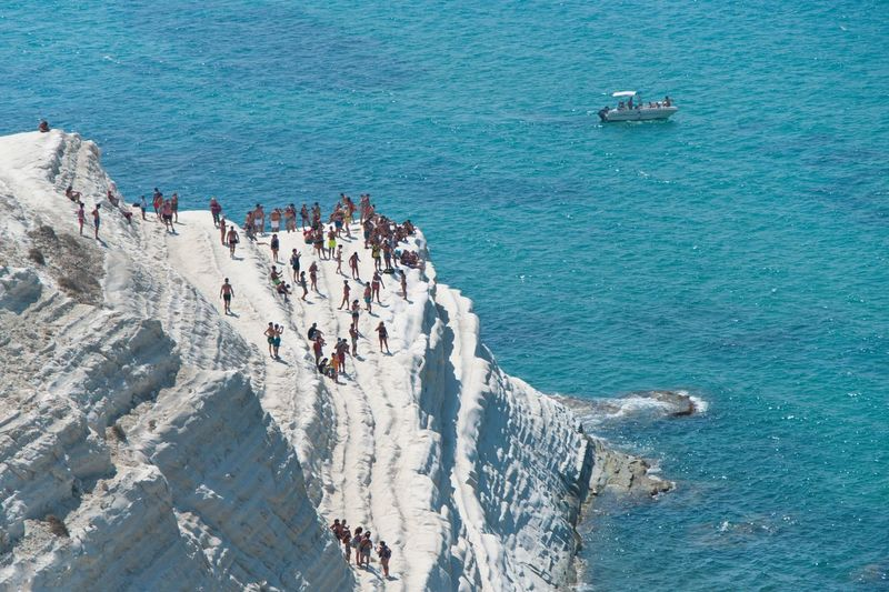 High angle view of people on scala dei turchi by sea