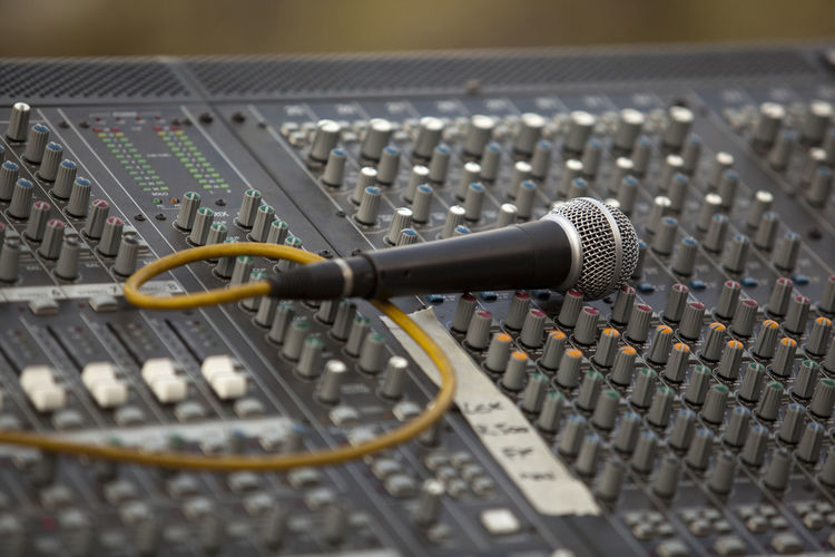 Close-Up Of Microphone On Sound Mixer