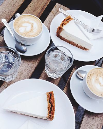 High angle view of cappuccino served on table