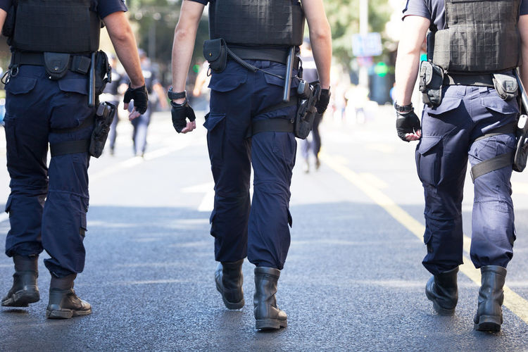 Armed police officers on duty, marching on a street Safety Security Law Protection Police Force Uniform Authority Protecting Police Patrol Police Law Enforcement Guarding Armed Forces Armed Brutality Public Order Order Street Terrorism Terror Attack Protest Civil Rights  Safe Police Uniform