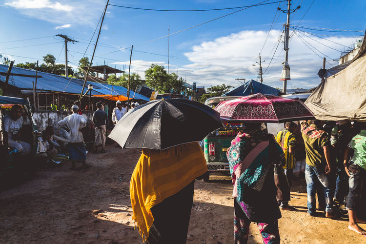 Suns out, Umbrellas out. Bangladesh Burqa Chittagong Hijab Lifestyles Market Market Stall Men Outdoors Sky Street Photography Sunny Travel Umbrella Women Paint The Town Yellow Focus On The Story The Traveler - 2018 EyeEm Awards