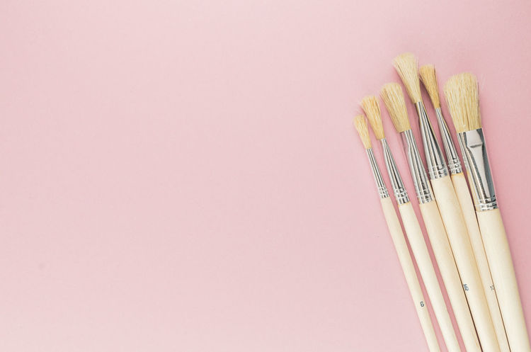 paintbrushes - pink surface Art And Craft Art And Craft Equipment Brush Choice Close-up Colored Background Copy Space Craft Creativity Indoors  Large Group Of Objects No People Paintbrush Pencil Pink Color Still Life Studio Shot Variation Wood - Material