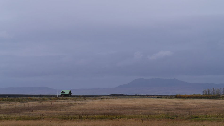 A lone house near Seljalandsfoss, Icleand Beauty In Nature Cloud - Sky Day Field Grass House Iceland Landscape Lone House Mountain Nature No People Outdoors Plains Scenics Seljalandsfoss Sky Tranquil Scene Tranquility