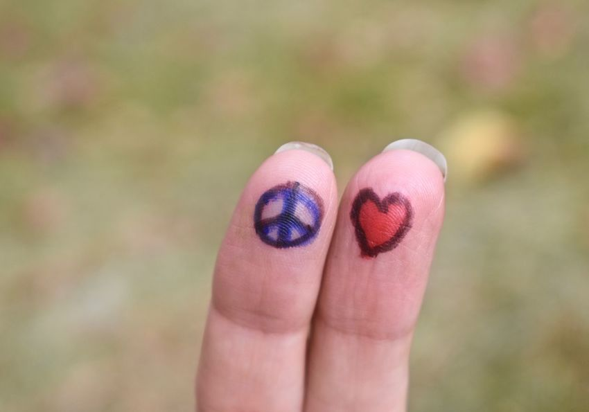 Woman expressing peace and love with marker pen drawing on her fingers Finger Art Fingers Playing Oneness Positive Message Quotes Signs And Symbols Unity Woman Power Art Creative Expressions Finger Face Good Cause Inner Peace Inspirational Inspiring Love And Peace On Earth <3 Love Hearts Peace And Love ✌❤ Peace Sign✌ Standing For A Standing For World Peace Symbolism