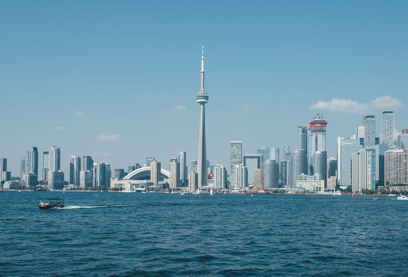Kayaking around Toronto Islands Architecture Building Exterior Built Structure City Cityscape Clear Sky Day Downtown District Kayak Modern Nautical Vessel No People Outdoors Sea Sky Skyscraper Tall - High Toronto Islands Tower Travel Destinations Urban Skyline Water Waterfront