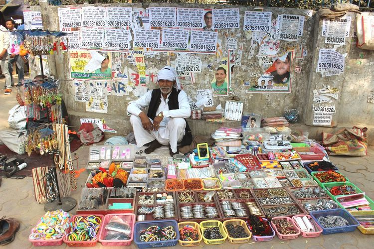 A street seller in New Delhi, India in December 2016 Work Streets India New Delhi Job Humans Of India Retail  Abundance For Sale Choice Variation Real People Market One Person Multi Colored Arrangement Market Stall Adult Business Retail Display Small Business Men Lifestyles Sale