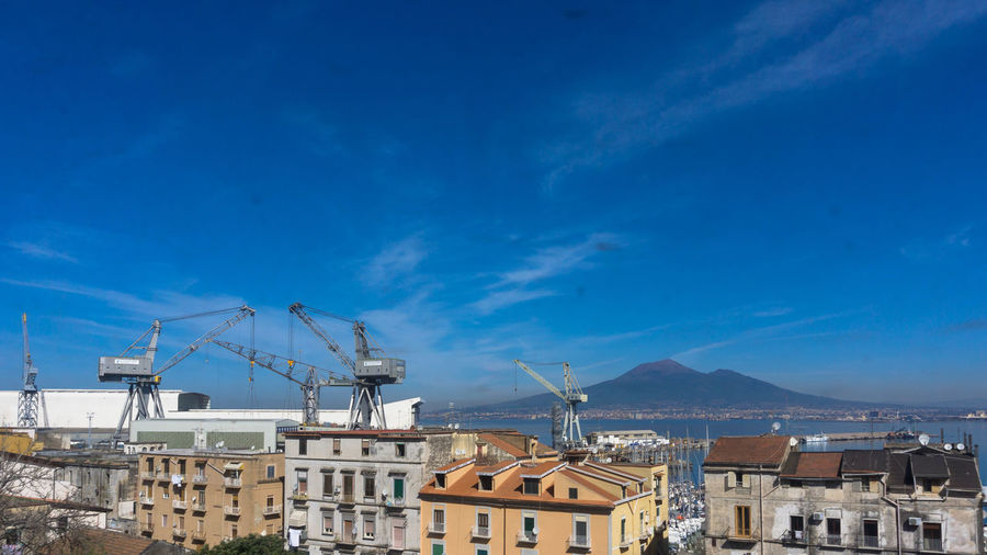 view on old houses in front of a harbour in Calabria, Italy Antenna Architecture Blue Building Exterior Calabria City Cloud Cloud - Sky Cranes Hafen Harbour House Italien Italy Kalabrien Mountain Residential Building Sea Sky Town Water