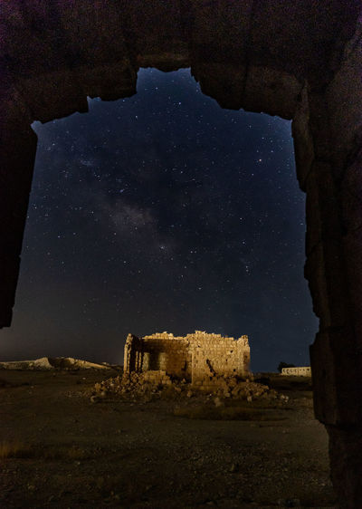 Old ruins against sky at night