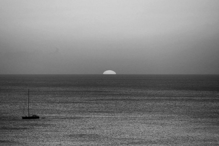 Black And White Friday Sea Horizon Over Water Tranquility Water Nature Scenics Tranquil Scene Beauty In Nature Clear Sky Sky Outdoors Waterfront No People Day Travel Destinations Beach Landscape Sailboat Nautical Vessel Sailing