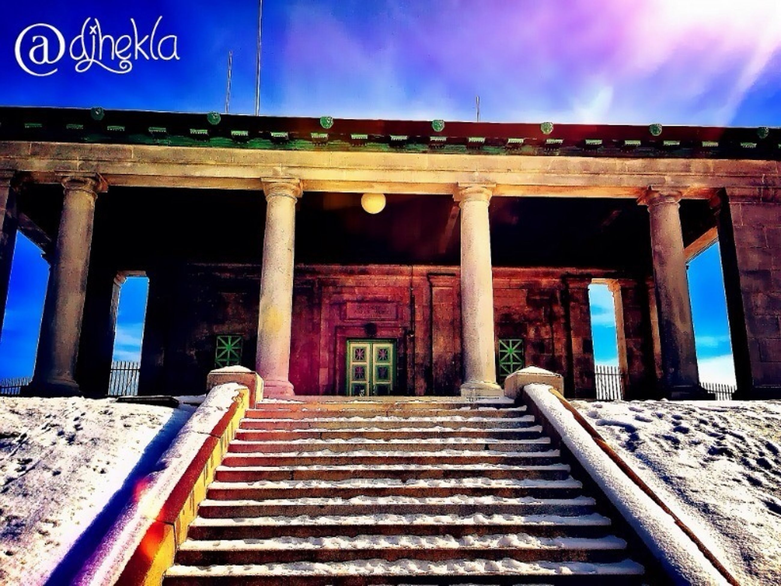 built structure, architecture, blue, sky, low angle view, building exterior, steps, sunlight, outdoors, no people, steps and staircases, railing, text, wood - material, cloud - sky, staircase, cloud, day, architectural column, auto post production filter