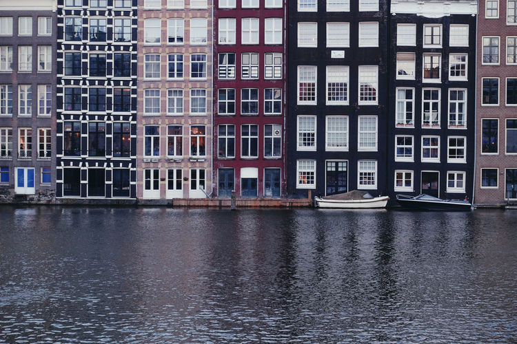 Building Amsterdam Netherlands Architecture Outdoors Transportation Reflection Building Exterior Built Structure Water Waterfront Window City Residential District Travel Destinations Row House River Colorful Boat Horizontal Minimalism Daylight Europe Travel Cityscape
