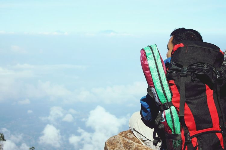 Rear View Of Hiker Against Sky