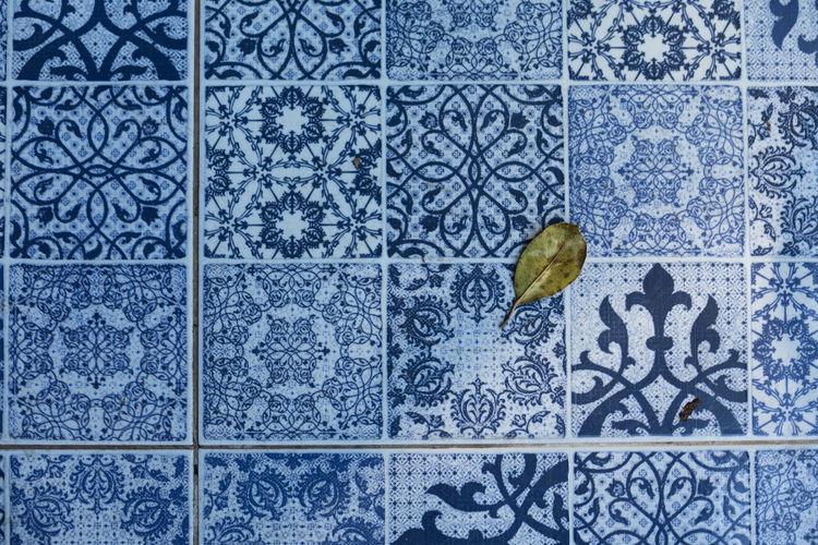 Full frame shot of butterfly on tiled floor