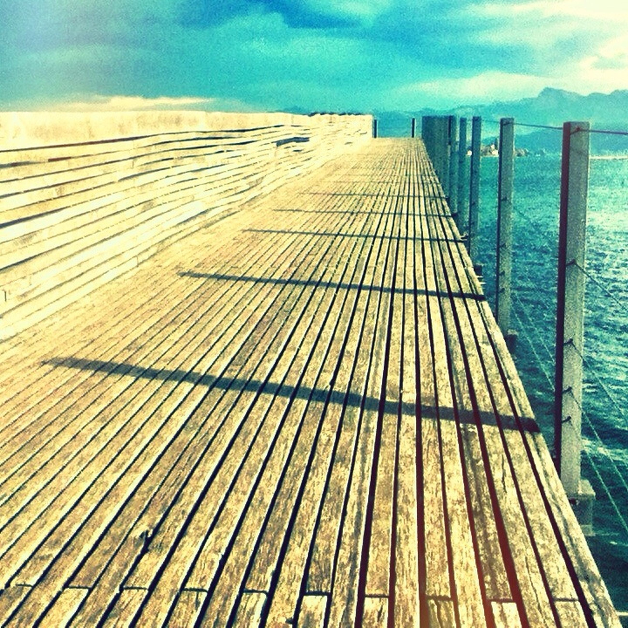 water, wood - material, pier, sea, the way forward, sky, boardwalk, wooden, railing, wood, tranquil scene, tranquility, diminishing perspective, jetty, nature, scenics, cloud - sky, beauty in nature, cloud, lake