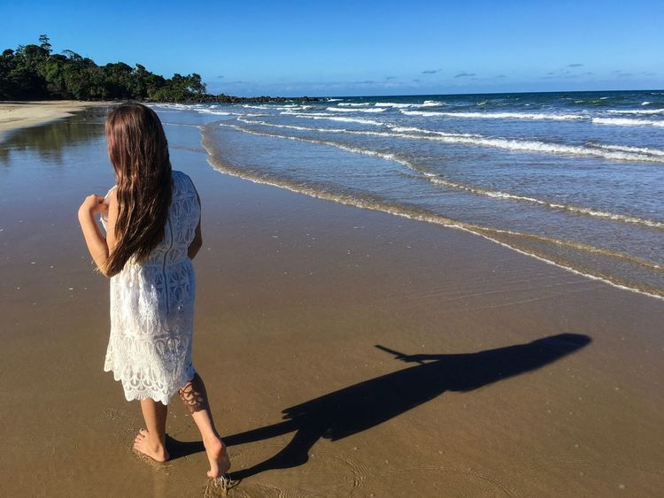 Girl walking along Mission Beach in Queensland, Australia. Sea Mission Beach Queensland Australia Water Real People Long Hair One Person Beach Rear View Leisure Activity Nature Horizon Over Water Sand Full Length Scenics Vacations Holidays Day Shadow Outdoors White Dress Girl Breathing Space The Week On EyeEm Lost In The Landscape An Eye For Travel
