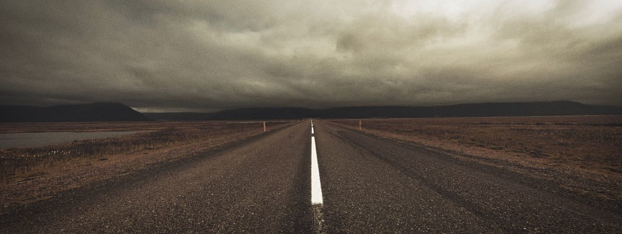 New edit. Road in Iceland. Clouds Horizon Over Land EyeEm Best Edits EyeEm Best Shots Road Transportation Marking Road Marking Direction Sky Symbol Nature The Way Forward Diminishing Perspective Outdoors Asphalt No People Cloud - Sky Environment Landscape