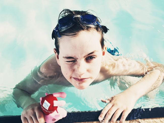 Swimming Goggles Boy Swimming Pool Blue Close Up Playing Squinting One Person Portrait People Looking At Camera Swimming Pool Headshot Water