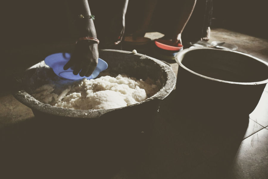 Prepping meals for the children in an African Orphanage in Uganda. The children were happy that they had a roof under their heads and one meal every day. Africa Black Bowl Food Indoors  Kitchen Moody Poor