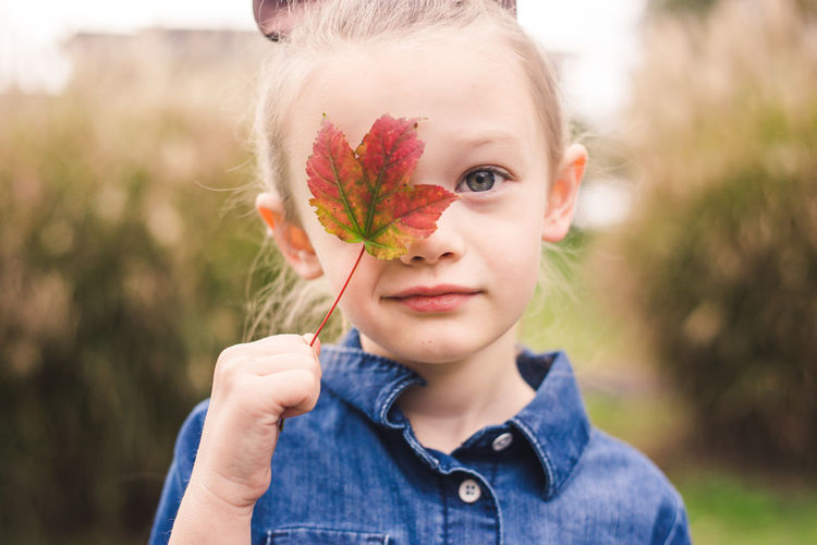 Fall Beauty Blond Hair Casual Clothing Child Childhood Close-up Day Fall Focus On Foreground Front View Girl Hair Headshot Holding Innocence Leaf Looking At Camera Nature One Person Outdoors Plant Portrait Pre-adolescent Child