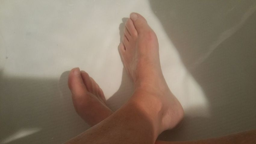 Croased Feet in water. Relaxation. Simple background. Crossed Relaxing Downtime Ultimate Best  Simple Minimalism Zen Shadow Toes Clean Spa Pedicure Meditation Ankle Low Section barefoot Shadow Human Foot Human Leg Close-up Toe Foot Leg Taking A Bath Human Toe Bathtub Domestic Bathroom Feet Skin
