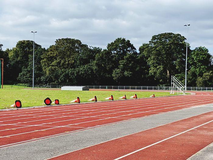 Orange cones laid side on at athletics tracks