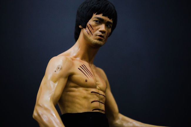 Shirtless Muscular Build One Person Men Standing Black Background Real People Statue Young Adult Close-up Indoors  Sportsman Human Hand Human Body Part Bruce Lee Day People