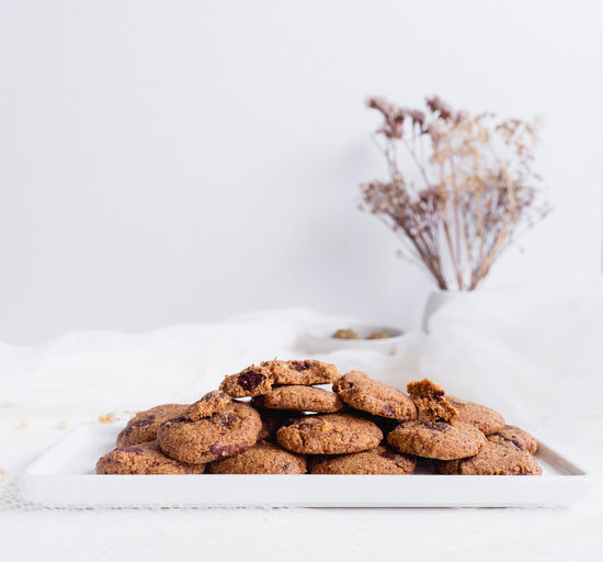 Chocolate Chip Cookies on white plate and white background Chocolate Chocolate Chip Cookie Chocolate Chip Cookies Eating Food And Drink Snack Snack Time! Brightly Lit Chocolate Chip Cookie Close Up Close-up Cookie Eating Healthy Focus On Foreground Food Food Photography Foodphotography Indulgence Ready-to-eat Sweet Food Temptation White White Background White Color