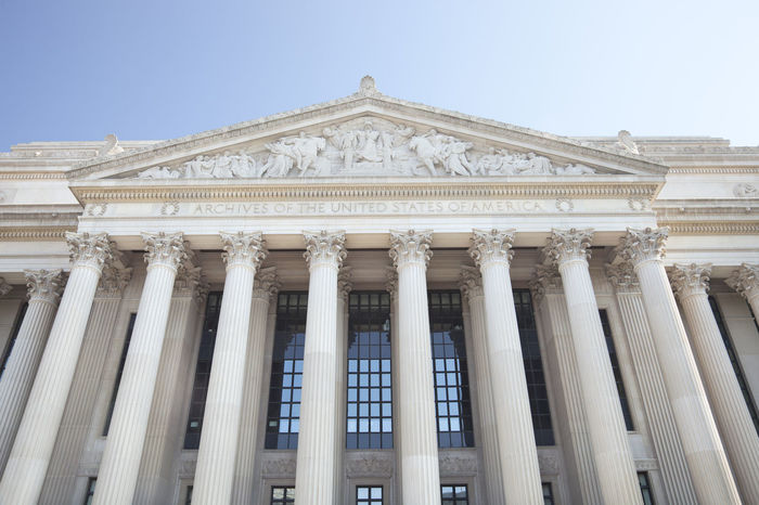 American Flag Architecture Blue Building Columns Corinthian Columns Exterior Historical National Archives No People Sky United States USA Washington, D. C. Washington, D.C.