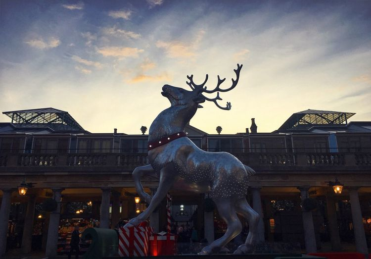 Postcode Postcards Covent Garden Christmas Statue Animal Representation Sculpture Built Structure Art And Craft Architecture Sky Building Exterior Cloud - Sky Dusk Travel Destinations Outdoors History City Dragon No People Day Animal Themes Reindeer