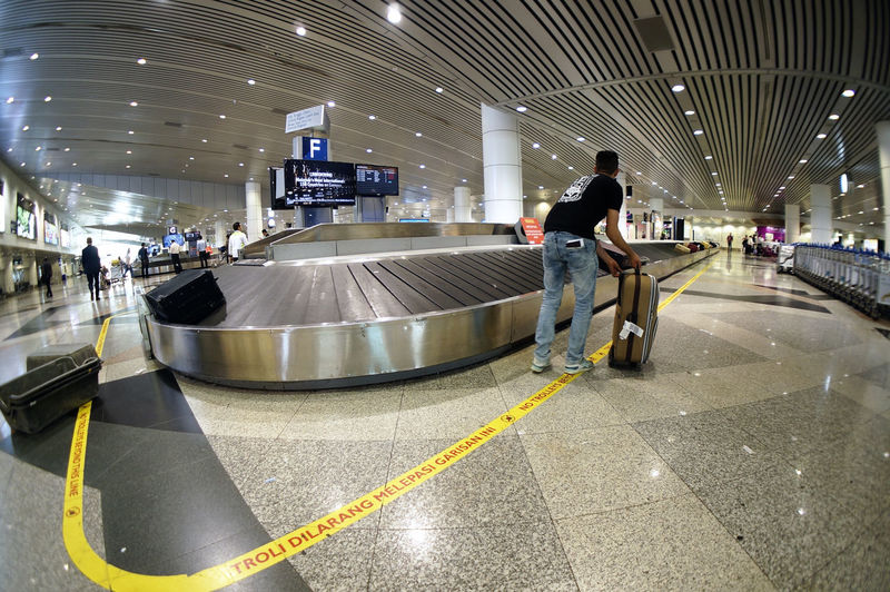 Baggage Island in the modern airport (luggage, airport, conveyor) with moving passenger Airport Bag Baggage Baggage Claim Indoors  Passenger Public Transportation Transportation Travel Trolley