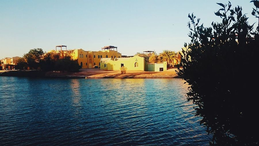 Live For The Story Thisisegypt Elgouna Sonyz3 Summertime Vesco Building Exterior Water Reflection Outdoors No People Built Structure Sky Architecture Tree Day City Nature