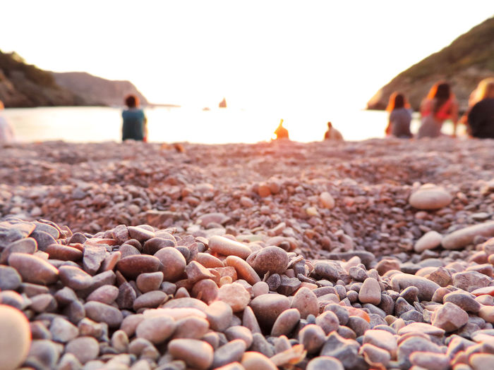 Benirrás Beach on Ibiza Island, people watching the sunset. Benirrás Beach Ibiza Ibiza, Spain Beach Beauty In Nature Benirras Clear Sky Close-up Day Ibiza Beach Land Nature No People Outdoors Pebble Rock Sea Selective Focus Sky Solid Stone Stone - Object Sunset Tranquility Water