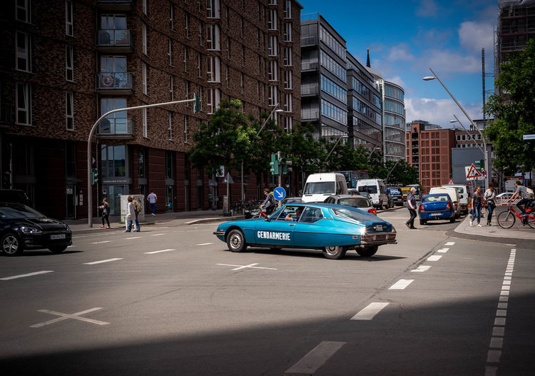Bonjour et Bienvenue à l'Hafencity / french gendarmerie citroen oldtimer, shining in the daylight, while crossing the street Citroën SM City Life French Car Hafencity Hamburg Nikon Open Edit Road The Street Photographer - 2018 EyeEm Awards Citroen Daylight Eye4photography  French Gendarmerie Light And Shadow Metallic Old Police Car Oldtimer Street Streetphoto_color Towers Trafic Urban Urban Photography Voiture