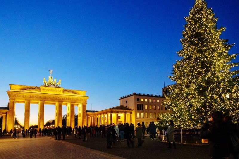 Architecture Built Structure Travel Destinations Building Exterior Large Group Of People Tourism Clear Sky City Gate Real People Outdoors Men City Statue Germany Urban Lifestyle Berlin Capture Berlin City Architecture Urban Olympus Christmas Tree Christmas Lights Brandenburg Gate
