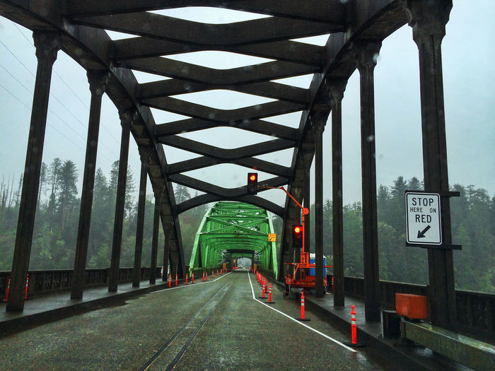 Historic Umpqua River Bridge at Reedport, Oregon. Architecture Bridge - Man Made Structure Built Structure Clear Sky Connection Construction Day Diminishing Perspective Engineering Food Land Vehicle Metal Oregon Outdoors Red Light Reedport Road Road Marking Sky Street Streetphotography Text The Way Forward Transportation Vanishing Point