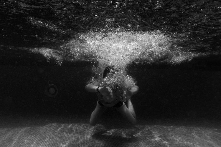 Front view of person swimming in pool